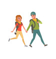 young couple walking with backpacks man and woman vector image vector image