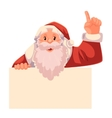Santa Claus holding a sign and pointing up vector image vector image