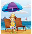 A boy with a rubber duck at the beach vector image vector image