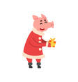 cute little pig character dressed in santa costume vector image vector image