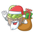 santa with gift lemon cupcake mascot cartoon vector image