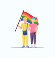 couple gays holding lgbt rainbow flag love parade vector image vector image