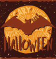 Happy halloween grunge emblem with a bat vector image