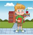 boy outside school building vector image