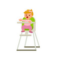 child girl in bahighchair with plate of vector image vector image