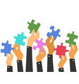 hands holding puzzles vector image