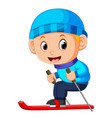 the boy in a blue jacket on skis vector image