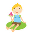 boy sittiing on grass eating watermelon vector image vector image