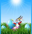 cartoon easter bunny painting easter eggs in the g vector image