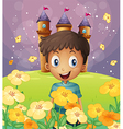 A happy boy in front of the castle at the hilltop vector image