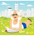 woman lying down on grass reading book vector image