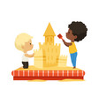 boys building sand castle children play together vector image vector image