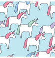 cute unicorns blue background seamless pattern vector image