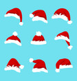 set santa hats isolated on blue background vector image vector image