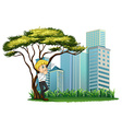 A man smoking under the tree across the buildings vector image vector image