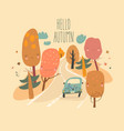 car is driving on road through autumn forest vector image vector image