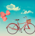 Retro bicycle with red heart shaped balloons vector image