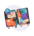 suitcase with packed clothes for travel in top vector image vector image
