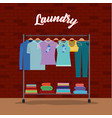 brick wall background of clothes in hangers with vector image