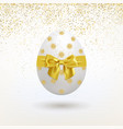 easter egg with a golden bow and a falling golden vector image vector image