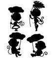 set monkey holding leaf silhouette vector image