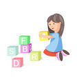 little girl builds pyramid cubes with letters vector image