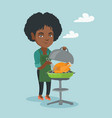 african woman cooking chicken on the barbecue vector image vector image