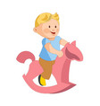 cute plump boy rides toy horse isolated vector image vector image