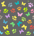 Colored butterflies and pawprints seamless pattern