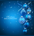 Christmas balls on blue background vector image vector image