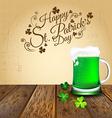 Green beer with Shamrock on wooden floor vector image vector image