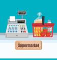 supermarket cash register with shopping basket vector image