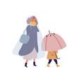 cartoon little kid holding umbrella walking under vector image vector image