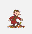 child having fun treading autumn leaves vector image vector image