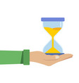 human hand holds a hourglass business and time vector image vector image