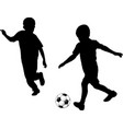 kids playing soccer silhouettes vector image