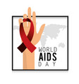 hand with red ribbon to aids day campaign vector image