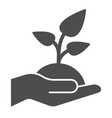 plant in hand solid icon sprout in hand vector image