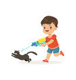 cute bully boy pouring a black cat out of a water vector image vector image