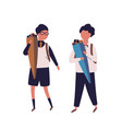 pair of boys dressed in uniform walking to school vector image vector image