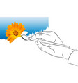 hand with a brush draws the paint vector image