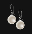 realistic pearl earrings isolated on black vector image vector image