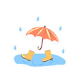 red umbrella and yellow boots in a puddle vector image vector image
