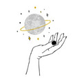 womens hand holding textured planet and stars