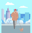 man walking dog on leash in winter city park vector image vector image