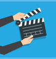 opened movie clapper board in hands vector image