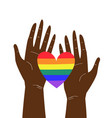 two black hands holding lgbtq rainbow heart vector image