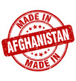 made in afghanistan red grunge round stamp vector image vector image