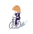 businessman ride on bicycle under umbrella vector image