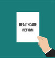 man showing paper healthcare reform text vector image